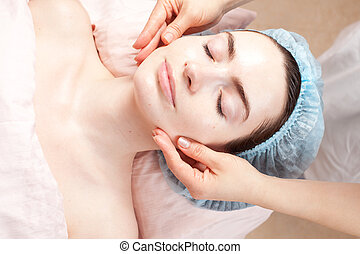 Beautiful woman with clear skin getting beauty treatment -...