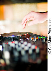 Close-up of deejay hand and turntable, selective focus