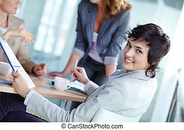 Business lady - Image of smiling female looking at camera in...