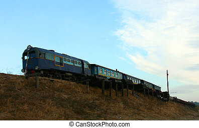 Narrow gauge railway - Several wagons of old trains stand on...