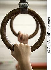 Gymnastic Rings - Human hanging in Gymnastic Rings