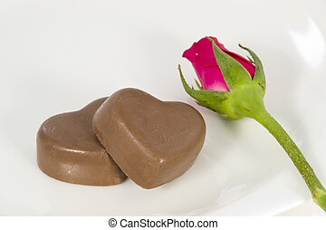 Chocolate heart and rose in the Valentines Day, white...