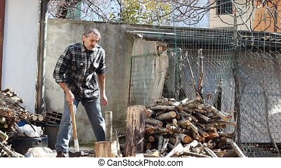 Lumberjack with Axe - woodcutter with axe working at rural...