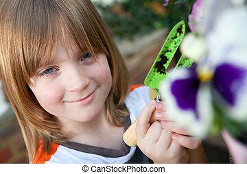 child garden flowers planting plant gardening