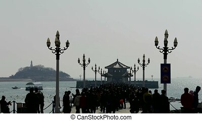 Many people at Qingdao pier of Qingdao Seaside.