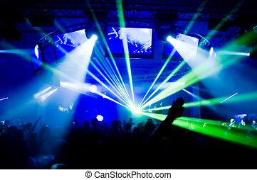 Concert, laser show, blurred motion