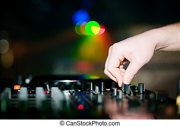 Close-up of deejay?s hand and turntable, selective focus
