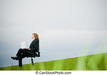 Businessman with laptop outdoors - Businessman with laptop...