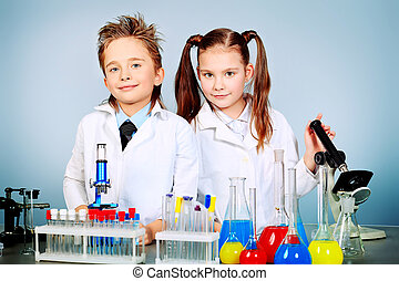 children science - Two children making science experiments....