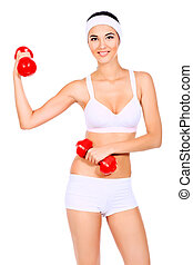 practice - Shot of a sporty young woman with dumbbells....