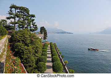 Tourist boat sails past the island of Isola Bella on Lake...