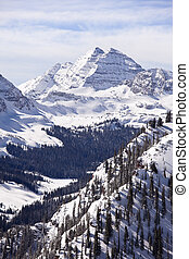 Maroon Bells With Snow - A winter landscape view, in...