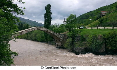 Landscape of fast river over Bridge of Queen Tamara in...