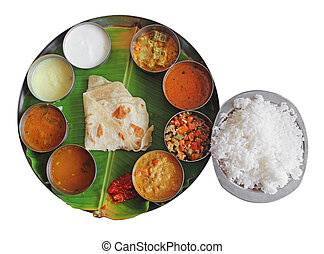 South indian plate meals on banana leaf on white