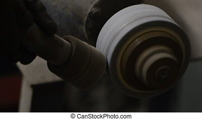 Grinding a steel rod for a tool on a high speed grinding...