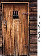 Old western jail door - old wild west jail door with small...