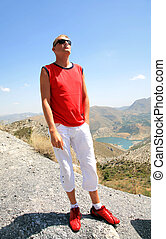 Relaxing man near lake in Sierra Nevada Spain