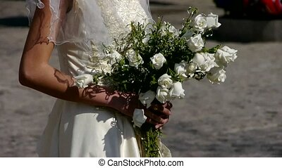 Bride carrying a bouquet of flowers