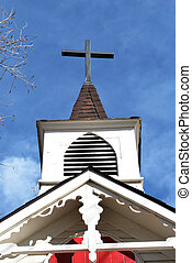 Church steeple. - Looking up at a church steeple and cross.