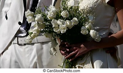Groom and bride together,Bride carrying a bouquet of flowers...