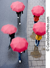 People with umbrellas