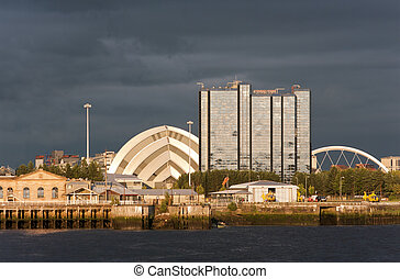 Riverside landmarks at sunset in Glasgow, Scotland -...