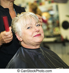 Woman and hairdresser - Older woman at the Hairdressers...