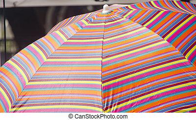 Colorful Striped Sun Umbrella - A colorful, striped, sun...
