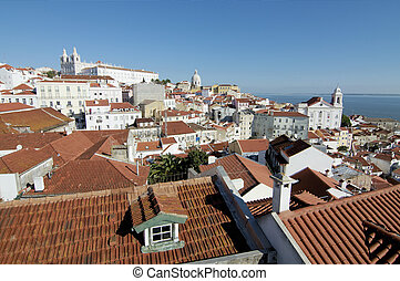 Alfama - View of Lisbon wth church and river on the...