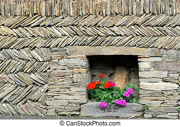wall and flowers - wall with diagonal stones and flowers