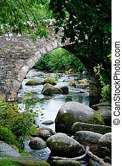 Bridge on Dartmoor in Cornwall - stone bridge with a river...