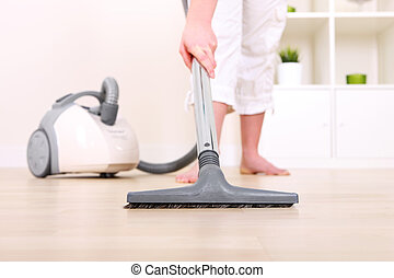 Vacuum cleaner - A picture of a young wife hoovering her...