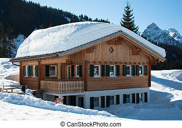 Skiing hut in Montafon - Wooden hut covered with a lot of...