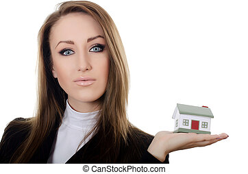 The business woman with small model of the house