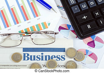 Graphs, charts, business table. The workplace of business people.