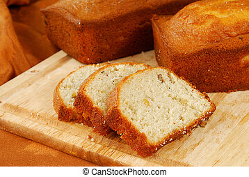 Banana nut bread - Two loaves of banana nut bread on a...