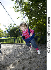 Swinging Girl - Young Happy Girl in the Swing