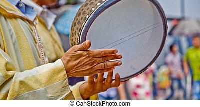 Tambourine. - Musician playing the tambourine at the fish...
