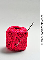 Crochet Thread and Neddle - A crochet needle is struck in a...