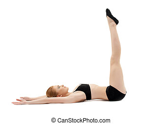 young woman training in black top for yoga