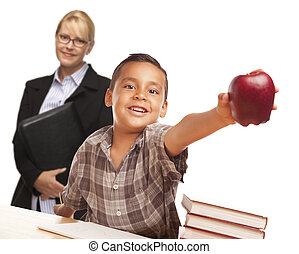 Hispanic Student Boy with Apple and Female Adult Behind.