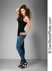 woman with curly hair in jeans