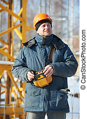 Builder with tower crane remote control equipment - Real...