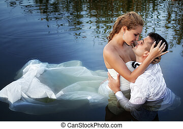 Love and passion - kiss of married couple in water - Love...