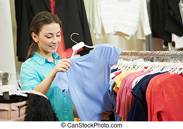 Young woman at apparel clothes shopping - Young woman...
