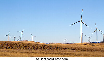 a windmill farm on a rual landscape energy concervation...
