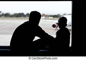 father and son at the airport - silhouettes of father and...