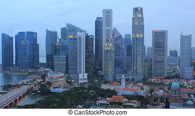 Time Lapse Singapore Skyline at Dusk. View to Financial /...
