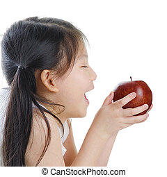 Healthy eating - Asian girl holding an apple on white...