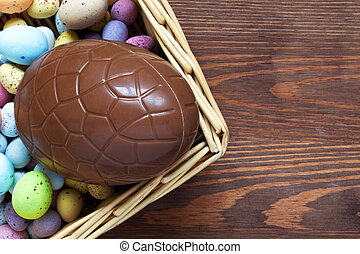 Large chocolate easter egg in a basket